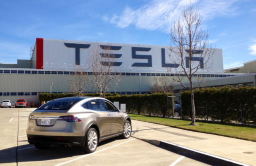 brand tesla in the front of the factory