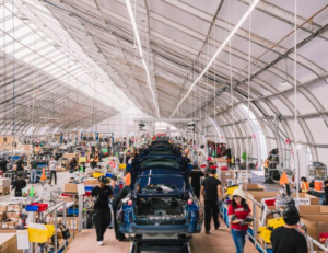 tesla production line is under a tent on the desert